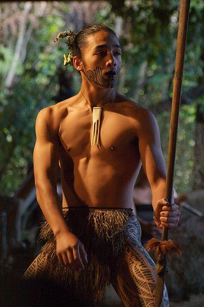 Native Maori man performing in a kapa haka group.