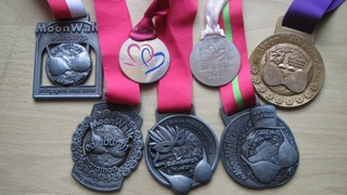 Catherine's previous medals from 5 MoonWalks and 2 Race For Life events!