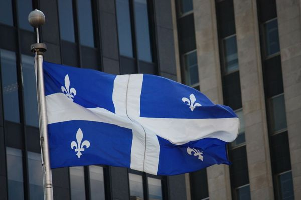 The flag of Quebec with four fleur de lys